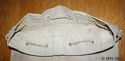 Inside view of the top of a Civil War Sea Bag - note the hand finished grommets and wide hand sewn stitches holding the bag together
